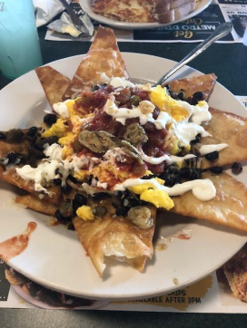huevos-rancheros-a-mexican-dish-consisting-of-black-beans-eggs-salsa-sour-cream-jalapenos-and-chorizo-sausage