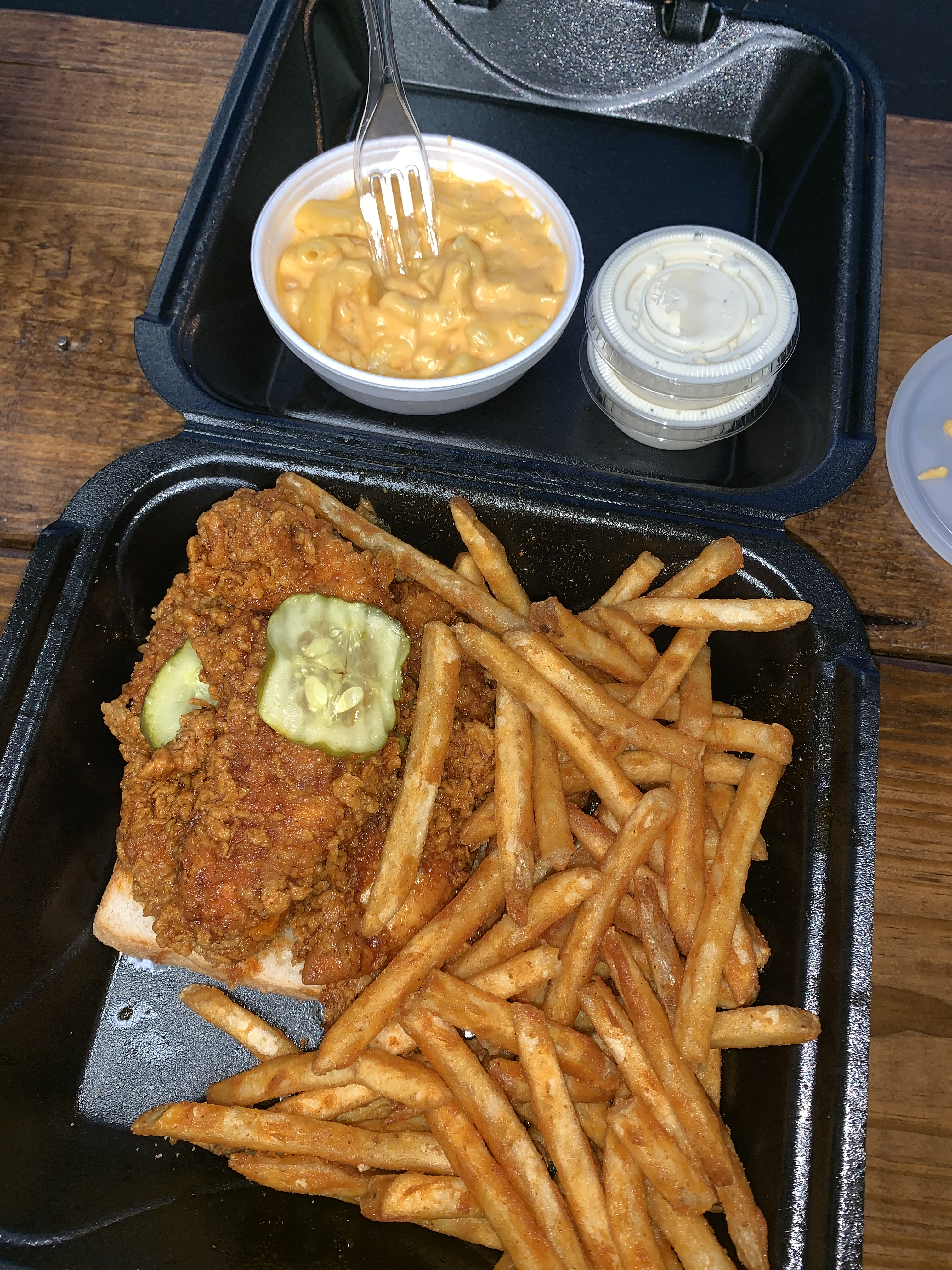 3 Tenders Nashville Hot dinner, with a side of fries and mac and cheese